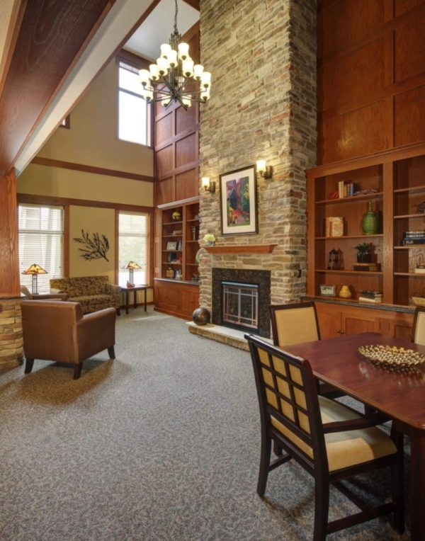 Heritage Elm Grove's beautiful entry with a fireplace and lounge area.
