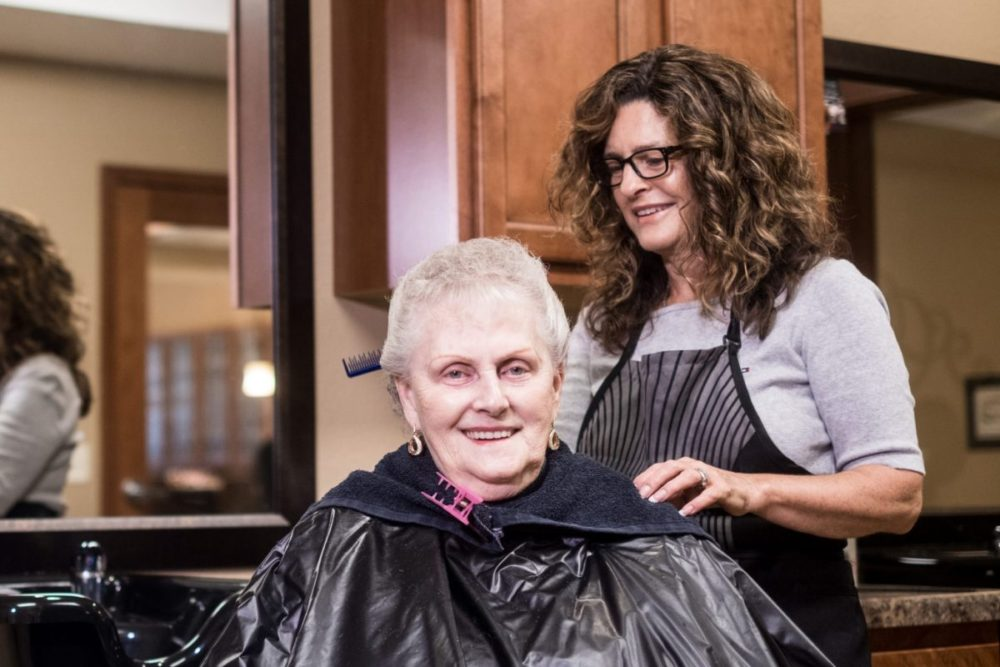 A Heritage Elm Grove resident in our full-service beauty salon.