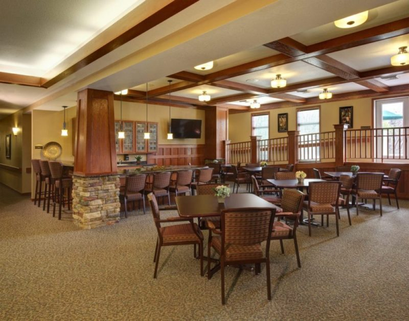 The pub and socialization area at Heritage Elm Grove with seating and bar area.