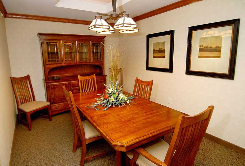 Cozy dining area with a dining set at Heritage Court Eau Claire.