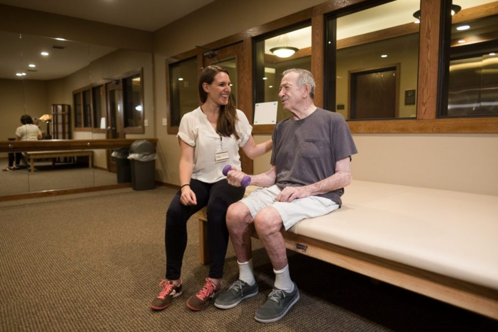 Man and woman work on physical therapy exercises at Heritage Lake Country.