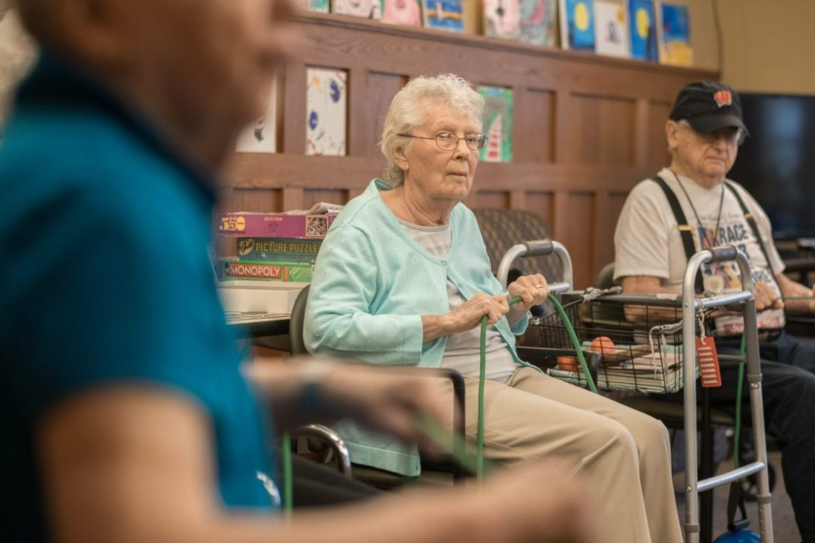 Residents enjoy an activity in our activity room at Heritage Middleton.
