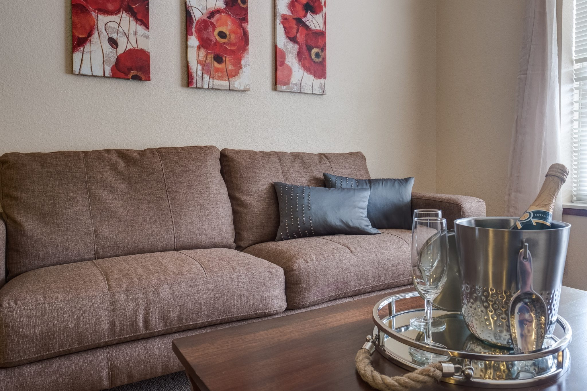 A couch and wine service in a spacious living room at Heritage Middleton.