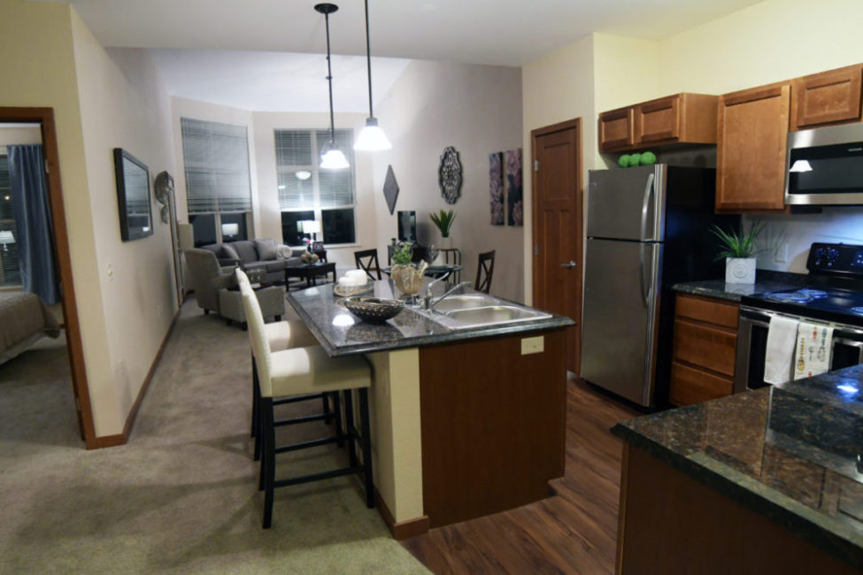 Independent living apartment at Heritage Muskego with full kitchen and living room.