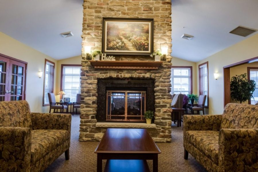 The Heritage Waukesha lobby with a fireplace and lounge area.