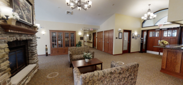 Heritage Court Waukesha's entry way with fireplace and lounge area.