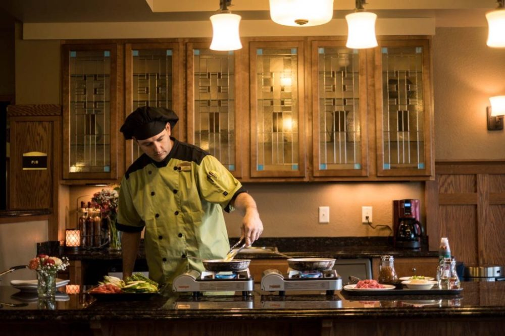Chef prepares a delicious and nutritious meal for our residents at Heritage West Allis.