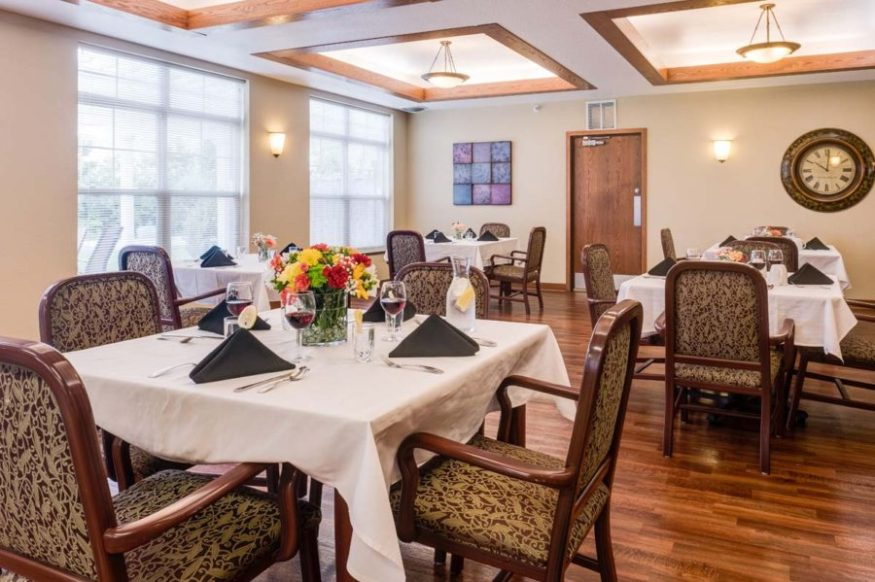 The dining area at Heritage West Allis offers residents an area to dine with tables for four.
