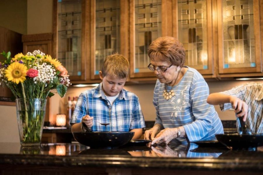 Senior woman and grandson making dinner in a kitchen at Heritage West Allis.