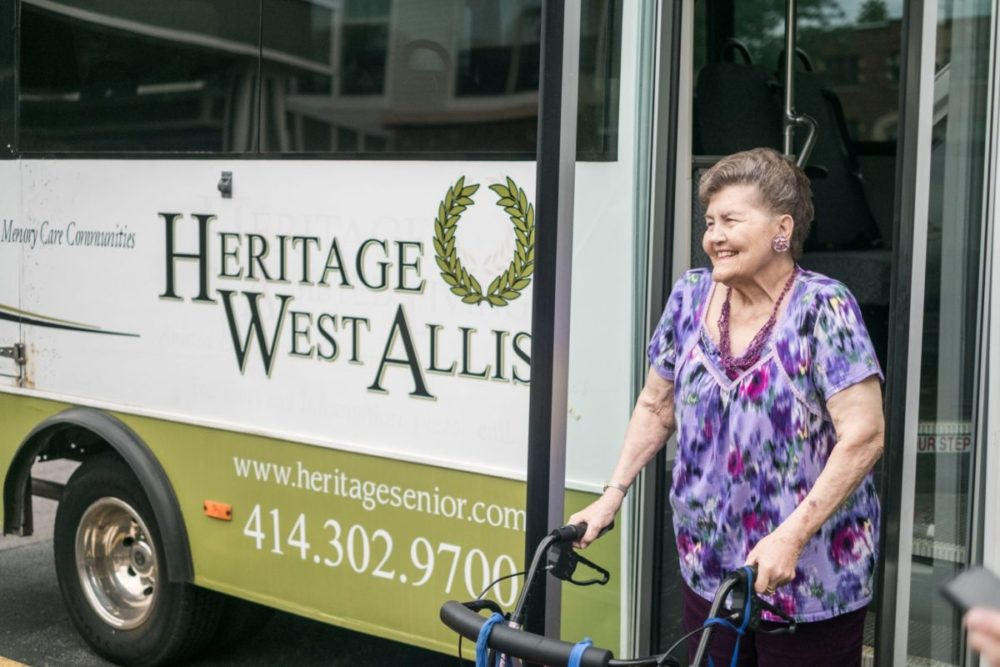 Senior woman gets off the Heritage West Allis bus for a scheduled group outing.