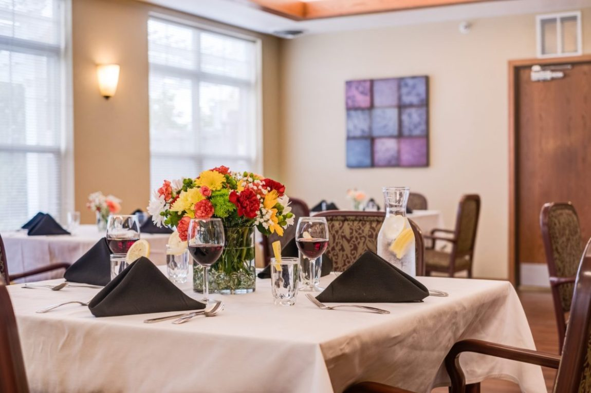 Close up view of our beautiful table set for four in our dining room at Heritage West Allis.