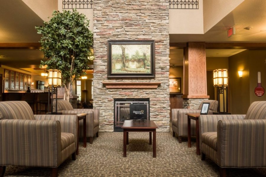 Heritage West Allis' spacious lobby with lounge chairs and fireplace.