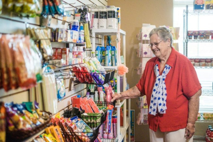 Senior woman shopping in the West Allis store for necessities and snacks.