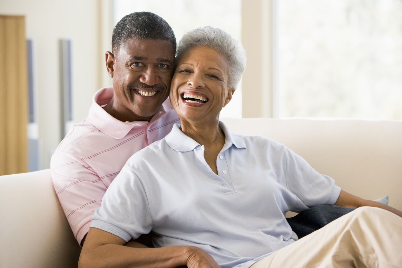 Happy couple at home in their senior living community.