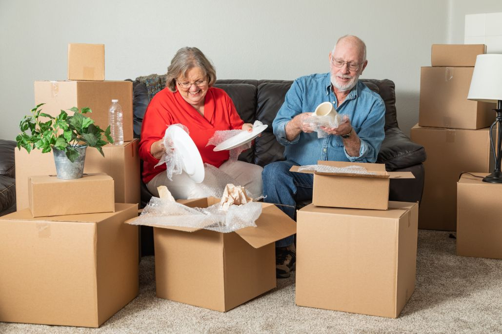 Senior couple downsizing their home for retirement.