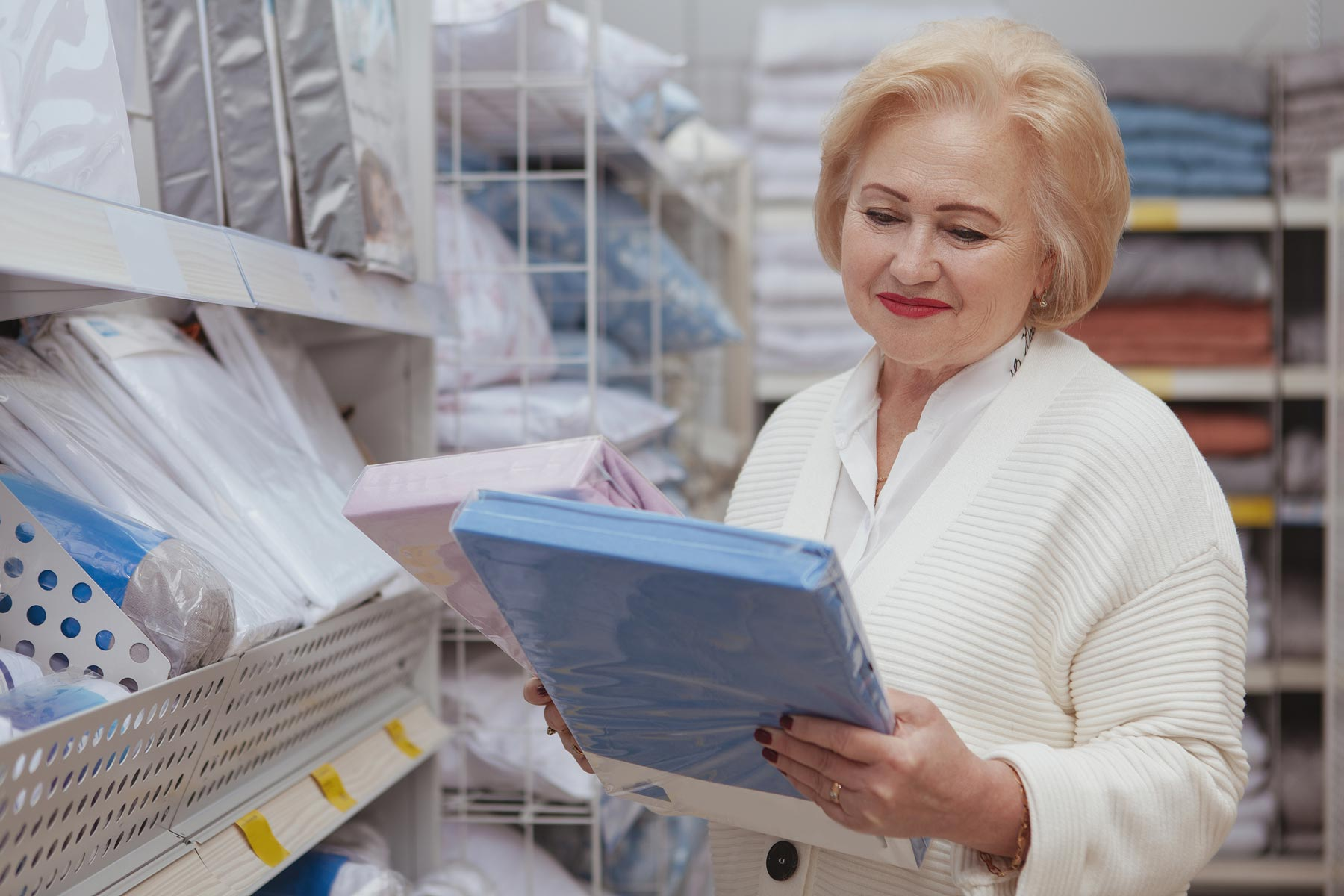 Senior woman shopping for items to decorate her retirement home apartment.