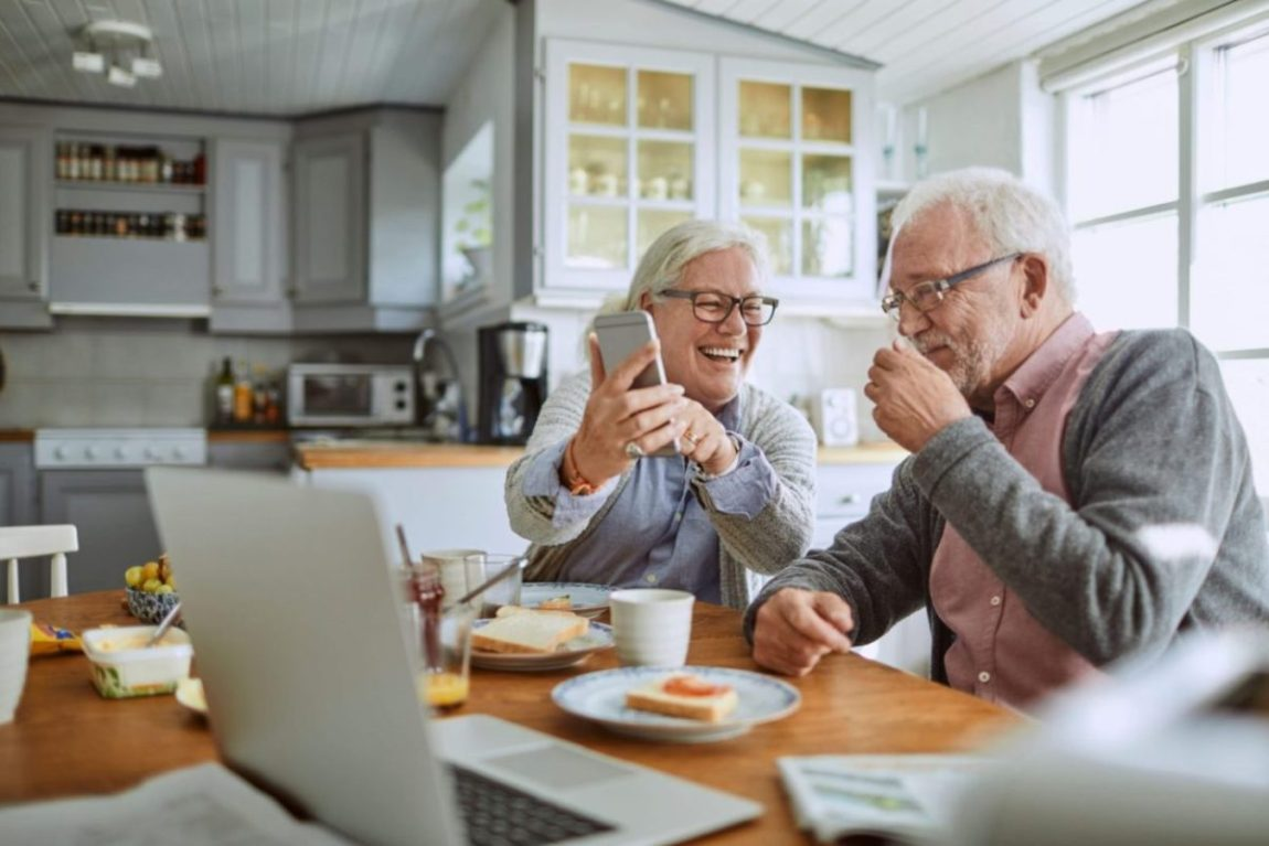 A couple enjoys a morning together in independent retirement living.