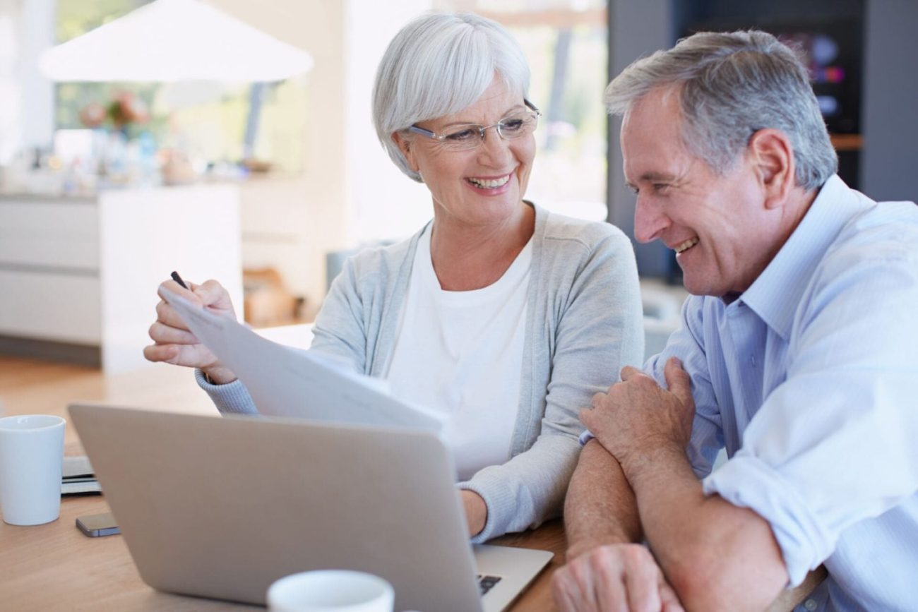A senior man and woman reviewing finances and preparing for retirement.
